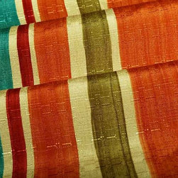 "Brazillia Stripe Upholstery Fabric in Multi - Brazillia Stripe Upholstery Fabric in Multi is a multi-colored, tropical striped fabric in vibrant shades of yellow, orange, blue, green, and red. Perfect for seats or pillows, this happy fabric will brighten up any interior design! Made with 100% polyester with a width of 62″. Repeat: V 23.62""H 13.50"". This fabric has fire rating and passes 50,000 Double Rubs abrasion test. Machine washable with warm water."