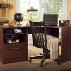 Bush - Corner Desk in Harvest Cherry Finish - Chair not included. Easily accessible wire management system. Ample storage cubbies. Charging station. Ventilated cubby back panel. File drawer. Full-extension ball-bearing slides. Tough durable surface. Attractive, nickel-plated metal drawer. Wipe clean. Warranty: One year. Made from particleboard and laminates. 59.45 in. W x 35.71 in. D x 30.16 in. H (106 lbs.). Installation GuideElegance that's comfortable in any office also works smartly at home. The Bush Furniture Harvest Cherry Cabot Collection Corner Desk offers ample storage and smart technology integration to make it a perfect fit anywhere. Get plenty of workspace for spreading out and accomplishing tasks. Sleekly designed lines and polished appointments make the Cabot Corner Desk a comfortable addition from the moment you sit down.