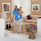 North States Extra Wide Swing Gate - Oh a great room with an open floor plan seemed like such a wonderful idea when you bought your house. But now baby's on the way and you need some way to keep him in the living room and out of that dangerous kitchen. It's the North States Extra Wide Swing Gate to the rescue! This extra wide gate can span over eight feet to create a barrier between rooms. The gate securely attaches to the wall with 4-point steel mounting hardware and is also ideal for keeping a puppy confined to the kitchen until he's housetrained. Although this gate features a childproof latch adults will find it easy to operate with just one hand - a plus since your other will probably be carrying a baby. The gate swings in out or both ways with the swing control hinge. Made from sturdy wood with an elegant slatted design this gate won't be an eyesore like some white plastic models. The gate removes from its hardware mount for storage when your child learns to use the stairs; simply reattach it when your next bundle of joy needs protecting. About North StatesWhether you're trying to protect your kids from your home or vice versa North States has the gate you need for any space. The company's plastic wood and metal gates are all easy to set up and certified by the Juvenile Products Manufacturers Association for safety. With products sold worldwide North States offers the most versatile and economical gates and enclosures in the industry. Your beloved little ones will be safe from the world... and the world from them... when you use North States gates.