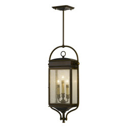Murray Feiss - Murray Feiss Whitaker Traditional Outdoor Hanging Light X-BTSA1147LO - This Murray Feiss Whitaker traditional outdoor hanging light is reminiscent of the classic English pocket lantern. This fixture, in an astral bronze finish, features a powder coated steel frame, clear seeded glass panels, a solid brass hinge and a latched door. Not only is this a beautiful piece for you outdoor space, but its' weather-resistant as well.