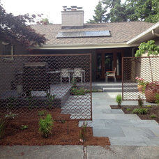 Midcentury Landscape by Greener Living Solutions, Inc