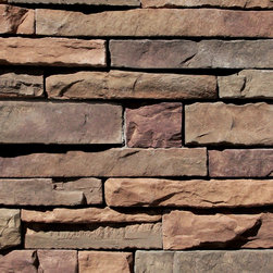 Coronado Chablis Dry Stack Stone Veneer Flats - Stacked stone around the fireplace adds a bit of a rustic feel.