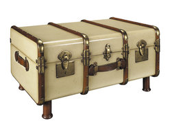 "Inviting Home - Trunk Coffee Table, ivory - Wood 1930s style travel trunk coffee table (antique ivory): 32-3/4"" x 18-1/8"" x 22-3/4""H; Finished in distressed antique ivory wood 1930s travel trunk. Inside the trunk wood grain finished in dark walnut. Trunk has professional brass hardware brass locks and keys steamed cherry wood bent slats. Trunk complete with hand turned legs to serve a further life as a coffee table. When the Gare Central was manned by porters carrying multiple travel trunks to the Pullman Coup� or your private carriage on the Orient Express... When travel was for restless souls with matching bank accounts and a yen for romance. When a Rolls coupe was delivered with a picnic trunk strapped to a tail-rack. And when this trunk held a complete setting for twelve including champagne flutes and dispensers for foie gras and Petrossian."