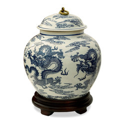 China Furniture and Arts - Hand Painted Porcelain Blue and White Imperial Dragon Jar - Known for its tranquil beauty, blue and white porcelain has long been a favorite import from China since the 18th century. Originally used to store rice, it is now considered a classic work of art for home decoration. This particular jar is hand painted in a flying dragons and Chinese clouds motif. Matching wooden stand sold separately. Part # RBR055