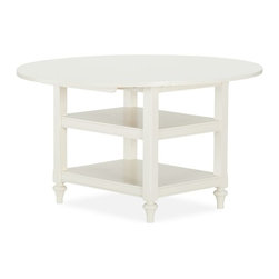 Shayne Drop-Leaf Kitchen Table, Antique White - I like that there are shelves underneath this table to store things, like cloth napkins, etc. I like the contrast of the angles of the bottom with round top as well.