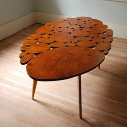 Large Circles Coffee Table by michaelarras - This unique and charming table is hand crafted by Etsy artist Micheal Arras. It has a bit of a mid-century feel, but the composition of circular pieces gives it a handmade contemporary feel as well.