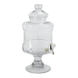 Ballard Designs - Jolie Beverage Dispenser - Crafted of mouth blown glass. 1 2/3-gallon capacity. Entertaining a crowd? Keep the beverages flowing with our beautifully crafted beverage dispenser with lid. Perfect for serving lemonade, sangria and more. It rests on a pretty turned pedestal that elevates the drip-proof spigot for easy pouring.Jolie Beverage Dispenser features:. .