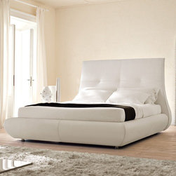 Cattelan Italia - Matisse Bed | Cattelan Italia - Made in Italy by Cattelan Italia. Drawing inspiration from the distinctively floral and feminine artworks of renowned French painter Henri Matisse, the Matisse Bed showcases delicate feminine curves in the bulbous shape of its generous headboard. An exemplary example of Italian quality and modern craftsmanship, its lavishly cushioned leather upholstery, button tufted detail on the headboard, and steel feet together bring an element of luxury and elegance into the design. For added functionality, an option for a pull-up under bed storage is available. Choose from a range of sizes and leather colors and prints. Mattress not included. Box spring not required. Platform structure.