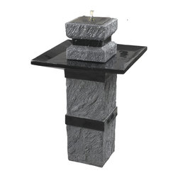 Monolith Outdoor Solar Fountain - Add the soothing and tranquil benefits of moving water with this premium Monolith Outdoor Solar Fountain. The look of rough, aged stone combines with contemporary black detailing; giving Monument it's memorable, aesthetic. Features four 0.1-watt LED bulbs for lighting and a panel tap switch. It comes with a remote on/off control, when you turn it on you can be across the yard or even indoors.