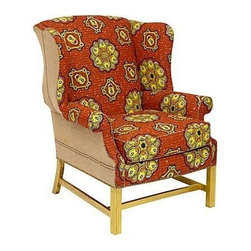 Batik Orange Wing Chair - Unlock your style with this wingback chair upholstered in bold orange and yellow vintage Batik cotton. Retro textile, retrieved from estate sale, features lock and key motif. Finished with brush fringe and gilt gold legs. Seat height 21''