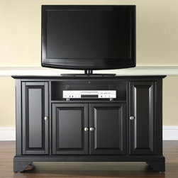 """Crosley - LaFayette 48"""" TV Stand - Enhance your living space with one of Crosley's impeccably-crafted TV stands. This signature cabinet accommodates most 52'' flat panel TVs and is handsomely proportioned featuring character-rich details sure to impress. Raised panel doors strategically conceal stacks of CDs/DVDs, gaming components and various media paraphernalia. Open storage area generously houses media players and the like. Adjustable shelving offers an abundance of versatility to effortlessly organize by design, while cord management systems tame the unsightly mess of tangled wires. Customize our distinct cabinets by selecting one of four collection styles (featuring tapered, traditional. turned or bun feet) in your choice of one of three signature Crosley finishes. This customizable cabinet approach is designed for easy assembly, built to ship and constructed to last. Features: -Raised panel doors.-Five adjustable shelves for storing electronic components, gaming consoles, DVDs and other items.-Adjustable levelers in legs.-Recommended TV Type: Flat screen.-TV Size Accommodated: 48"""".-Powder Coated Finish: No.-Gloss Finish: No.-Material: Hardwood and veneers.-Solid Wood Construction: No.-Distressed: No.-Exterior Shelves: Yes -Number of Exterior Shelves: 1.-Adjustable Exterior Shelves: No..-Drawers: No .-Cabinets: Yes -Number of Cabinets: 3.-Number of Doors: 4.-Door Attachment Detail: Pin hinge.-Interchangeable Panels: No.-Magnetic Door Catches: Yes.-Cabinet Handle Design: Knob.-Number of Interior Shelves: 5.-Adjustable Interior Shelves: Yes..-Scratch Resistant : No.-Removable Back Panel: No.-Hardware Finish (Finish: Black): Brushed nickel knobs, steel hardware.-Hardware Finish (Finish: Classic Cherry, Vintage Mahogany): Antique brass knobs, steel hardware.-Casters: No .-Accommodates Fireplace: No.-Fireplace Included: No .-Lighted: No .-Media Player Storage: Yes.-Media Storage: No .-Cable Management: Hole in back for wires.-Remote Control Included: No.-Batteries R"""