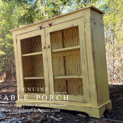Custom Farmhouse Furniture - Our Waldo cupboard shown with optional wire doors finished in Sweet Mustard over Sicily Classic with Summer distressing.