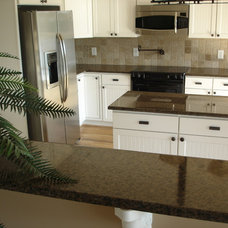 Traditional Kitchen Cabinetry by Granite Countertops by Mogastone