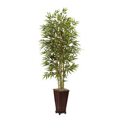 Nearly Natural - 6' Bamboo Tree with Decorative Planter - There are certain plants and trees that invoke particular feeling, and the Bamboo is certainly one of them. One look, and you get a feeling of the Orient, perhaps sunny, warm places, and soft breezes. We can't guarantee a breeze with this silk reproduction, but we can guarantee that it'll look great as part of your home or office decor. Makes a thoughtful gift as well.