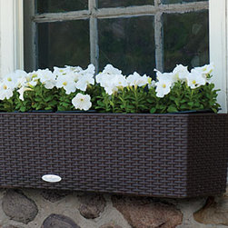 "Balconera Self Watering Planter - Plants displayed in planter boxes are such a cute idea but they can often be difficult to keep watered. In addition to looking great, these planter boxes are designed with a ""sub-irrigation system that keeps your plants from drying out quickly.  I love the wicker appearance of these window boxes.  They look like real wicker but are made of a durable material that can stand up to the weather."
