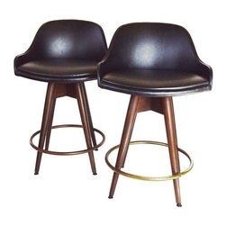 Used Chet Beardsley Swivel Bar Stools - A Pair - Great Mid-Century Modern Chet Beardsley style bar stools. As found, this pair is in excellent vintage condition. The seats are very comfortable barrel backs that swivel in a black Naugahyde.  The legs are solid wood with great patina.  The pair is unmarked by a maker but attributed to Chet Beardsley.  Seat height is 24 inches tall.  Please note, there are minor nicks in the vinyl that have been repaired.
