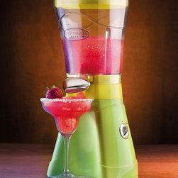 Nostalgia Products - Margarita & Slush Maker - Includes carrying bag with straps and pockets and drip tray. Convenient cord storage. Grind and shave mechanism. Detachable tank base. Dispensing spout. Quick cleanup. Powerful motor shaves ice in 1 minute. Wattage: 20 W. Perfect for margaritas, daiquiris, pina coladas and so much more. Warranty: 90 days. Weight: 4 lbs.The Margarita and Slush Maker is a frozen drink machine that will add thirst-quenching fun to any occasion! It uses crushed ice or small ice cubes from the freezer and not only makes fantastic margaritas, but can also mix up batches of favorite frozen drinks such as daiquiris and slushes for the kids!