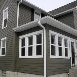 Gray House Siding with White Moldings - James Hardie Fiber Cement Siding Materia - James Hardie Siding: Timberbark, Plank Lap Siding