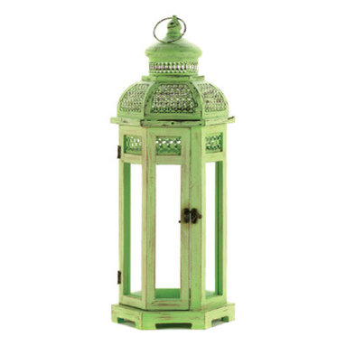 n/a - Tall Green Tower Lantern - Intricate cutouts decorate the green finish of this exotic Tower candle lantern.  The slender clear glass panels allow candlelight to shine brightly while the sturdy wooden frame allows hanging or setting on a tabletop.  Wood, glass and iron.  Candle not included.