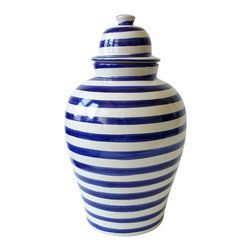 Blue Striped Tibor - This classic Mexican ceramic urn is hand-painted in a fresh, modern blue and white stripe pattern that conjures up the feel of the seaside. The cobalt blue is neutral enough to blend in with nautical or minimal contemporary styles, yet vibrant enough to sing next to other bright colors and patterns. Set it on a tiled floor or patio, or on a shelf or side table, either lidded or as a vase.