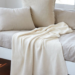 Cream Knit Blanket - I just want to curl up with this winter white blanket and watch the snow fall outside my window. I may have to stay wrapped up in its soft cotton knit all day.