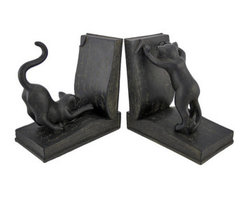 Decorative Black Reading Cat Bookends - This pair of decorative bookends is the `purrr-fect` accent to the bookcase, shelf, or desk of any cat lover. They feature a curious bespectacled cat, examining an open book with a magnifying glass. Made of cold cast resin, each bookend measures 6 1/4 inches tall, 6 inches long, 3 1/2 inches wide and has foam pads on the bottom to prevent it from scratching delicate surfaces. These bookends make a great gift for feline fanatics and avid readers, and are sure to be admired.