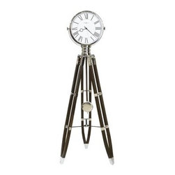 Howard Miller Chaplin Floor Clock - Lights, camera, action! The Howard Miller Chaplin Floor Clock puts your style right in the spotlight. The unique, vintage-Hollywood inspired design features a classic wood tripod base that beautifully contrasts the sleek chrome bezel. Quarter-hour chimes play Ave Maria or Westminster chimes, while hourly chimes feature Bim Bam or Westminster. Volume control and night shut-off options ensure it wont be a pest about announcing the time.The Howard Miller StoryIncomparable workmanship, unsurpassed quality, and a quest for perfection - these were the cornerstones of the company Howard C. Miller founded in 1926, at the age of 21. Even then, Howard Miller understood the need to create products that would be steeped in quality and value.Howard Miller was schooled in the fine art of clockmaking by his father, Herman, in the Black Forest region of Germany. Howard developed into a visionary whose keen sense of innovation spawned a tradition of excellence that has been uncompromised through three generations.A highly respected brand, Howard Miller maintains its popularity because of the company's commitment to quality. Every product manufactured at the company's sprawling facility in Zeeland, Michigan, undergoes stringent tests and exceeds industry standards to ensure a lifetime of enjoyment.