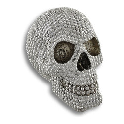 Zeckos - Metallic Silver Bejeweled Human Skull Statue - This is a wickedly awesome human skull figure / statue that appears bejeweled with hundreds of brilliant gemstones. Carefully carved and cast in resin, this statue has faceted ridges that look like gemstones, and is finished in a chrome silver enamel to make the stones shine It stands 6 inches tall, is 5 1/2 inches wide and 7 inches deep. It makes a great gift for any skull or pirate collector