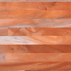 African Mahogany Exotic Hardwood Flooring - African Mahogany has a color range from medium and reddish brown to amber. This vibrant wood is not only beautiful but highly durable. It has a remarkable ability to retain its shape despite temperature and humidity fluctuation and is highly resistant to rot.