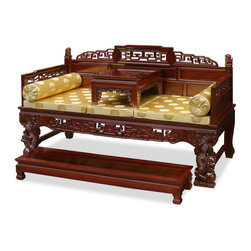 China Furniture and Arts - Rosewood Imperial Palace Day Bed - This exquisite day bed exhibits the grandioso tradition of the imperial court in the 19th century of China. Intricately hand carved dragons decorates the legs and the front of the bed. Deep enough for comfortable reclining position. When sit upright the feet conveniently rest on the foot-bench. A unique piece of furniture despite its history, now the top table can be used to place tea or coffee when friends are visiting or to hold books and small decorative objects. Made of rosewood with traditional joinery technique for long lasting durability. Hand applied rich mahogany finish enhances the extraordinary beauty and opulence of solid rosewood. Light assembly required. Silk cushions and pillows included.