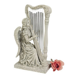 Design Toscano - Music from Heaven Angel Statue: Small - KY47015 - Shop for Statues and Sculptures from Hayneedle.com! Enjoy the beauty and sound of the Music from Heaven Angel Statue: Small. This angel has her harp complete with chimes for strings at her fingertips. Cast from designer resin this piece features a realistic stone finish and is perfect for a variety of settings in the home.About Design Toscano: Design Toscano is the country's premier source for statues and other historical and antique replicas which are available through our catalog and website. We were named in Inc. magazine's list of the 500 fastest growing privately-held companies for three consecutive years - an honor unprecedented among catalogers. Our founders Michael and Marilyn Stupak created Design Toscano in 1990. While on a trip to Paris the Stopkas first saw the marvelous carvings of gargoyles and water spouts at the Notre Dame Cathedral. Inspired by the beauty and mystery of these pieces they decided to introduce the world of medieval gargoyles to America in 1993. On a later trip to Albi France the Stopkas had the pleasure of being exposed to the world of Jacquard tapestries that they added quickly to the growing catalog. Since then our product line has grown to include Egyptian Medieval and other period pieces that are now among the current favorites of Design Toscano customers along with an extensive collection of garden fountains statuary authentic canvas replicas of oil painting masterpieces and other antique art reproductions. At Design Toscano we pride ourselves on attention to detail by traveling directly to the source for all historical replicas. Over 90% of our catalog offerings are exclusive to the Design Toscano brand allowing us to present unusual decorative items unavailable elsewhere. Our attention to detail extends throughout the company especially in the areas of customer service and shipping.