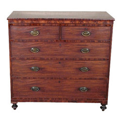 Antique English Georgian Flame Mahogany 5 Drawer Chest of Drawers c1810 - This is a gorgeous antique English Georgian flame mahogany chest of drawers. It has an elegant crossbanded top surface and it features a total of 5 lined drawers well constructed with dovetail joinery and they have beautiful oval brass handles with unique hardware.This piece may show minor age appropriate signs of wear and imperfections and one back feet has inactive worm holes but as shown it is overall in very good cosmetic and structural condition and it is strong, sturdy and very heavy! This handsome piece of furniture will make a great addition to any room you choose to display it in.