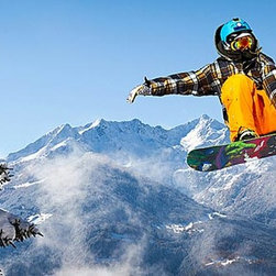 Magic Murals - Snowboarder in Flight Panorama Wall Mural -- Self-Adhesive Wallpaper by MagicMur - This snowboarder is captured in flight between two snow covered fir trees with blue skies and snowy mountains in the background.  An extreme shot of an extreme athlete.