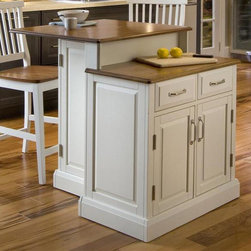 HomeStyles - 3-Pc Kitchen Island Set - Includes two-tier island and two stools. Honey oak top. Two storage drawers. Two door storage cabinet with two adjustable shelves. Compact eating area with two hidden storage cabinets. Nickel hardware. Magnetic push latches. Provides the utmost functionality with its ample preparation space. Distressed oak chair seat. Made from Asian hardwood. White finish. Made in Thailand. Counter top height from the floor: 30.5 in. H. Stool: 17.75 in. W x 22.25 in. D x 40.5 in. H. Kitchen Island: 30 in. L x 39.25 in. W x 36.5 in. H. Island Assembly InstructionsThe woodridge kitchen island provides a space-saving solution for the family on the go. This island provides the utmost functionality with it's ample preparation space.