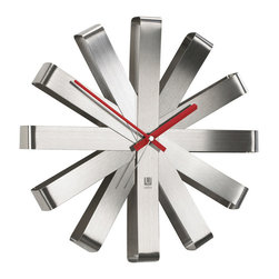"""Umbra - Ribbon Stainless Steel Wall Clock by Umbra - classic design with mid-century appeal that compliments virtually any home or office decor. Bent steel """"ribbons"""" form the clock's shape and mark the hours. Operates on one AA battery (not included)."""
