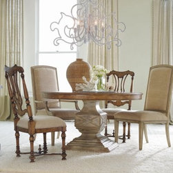"Hooker Furniture Sanctuary 5 Piece Round Pedestal Dining Table Set - Turn your dining room into a sanctuary with the Sanctuary 5 pc. Round Pedestal Dining Table Set. This collection features a classical timeless design that's been updated and restyled for today's casual living. Its contemporary round table has a rich dune base and intricately detailed base in a lighter beach finish. The round table and its four chairs are all constructed of sturdy hardwood solids and attractive ash veneers. Choose between the mirage side chair in dune with upholstered fabric and nailhead accents or the splat back chair with its exquisitely carved frame and cushiony seat. Chairs measure 20W x 23D x 44H inches. Table measures 54L x 54W x 30H inches.Not available for sale in, or delivery to, the state of California.About Hooker Furniture CorporationFor 83 years, Hooker Furniture Corporation has produced high-quality, innovative home furnishings that seamlessly combine function and elegance. Today, Hooker is one of the nation's premier manufacturers and importers of furniture and seeks to enrich the lives of customers with beautiful, trouble-free home furnishings. The Martinsville, Virginia, based company specializes in lifestyle driven furnishings like entertainment centers, home office furniture, accent tables, and chairs.Construction of Hooker FurnitureHooker Furniture chooses solid woods and select wood veneers over wood frames to construct their high-quality pieces. By using wood veneer, pieces can be given a decorative look that can't be achieved with the use of solid wood alone. The veneers add beautiful accents of color and design to the pieces, and are placed over engineered wood product for strength. All Hooker wood veneers are made from renewable resources and are located primarily on the flat surfaces of the furniture, such as the case tops and sides.Each Hooker furniture piece is finished using up to 30 different steps, including 13 steps of hand-sanding and accenting. Physical distressing is done by hand. Pieces receive two to three coats of solid lacquer to create extra depth and add durability to the finish. Each case frame is assembled using strong mortise-and-tenon joints, which are then reinforced by mechanical fasteners and glue. On most designs, end panels extend to the floor to add strength and stability. Panel-style furniture features strong panel and frame construction to help avoid warping.Your Hooker furniture features finished case interiors to eliminate unsightly ""raw wood"" and to help protect items you may store inside drawers or cabinets. Drawer parts are given a urethane or lacquer finish to create smooth action and durability. All drawers use dovetails, either English or French, for years of problem-free use. Drawer bottoms are constructed from plywood and attached to the plywood drawer sides via the use of hot glue and/or wood glue blocks. Most drawers are full width, depth, and height to provide the maximum amount of storage space."