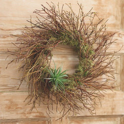 "Viva Terra - Manzanita Air Plant Wreath - Our wreath suppliers travel to centralOregon to hand-harvest the manzanitabranches used in this exceptional wreath.Filled with green moss and accented withan airplant ""bow,"" it surely stands outin a crowd. WREATH 18""DIAM. HANGER 13""L"