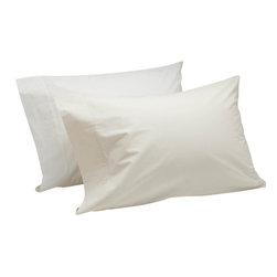 Coyuchi - 220 Percale Pillowcase King White - Pure organic cotton in a classic percale weave makes these sheets a must-have for any linen closet. Wonderfully crisp, yet soft on the skin, they're perfect for warm nights-or warm sleepers. Destined to get smoother and softer with every wash, they are woven to a durable 220 thread count.