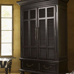 Tommy Bahama Home - Trafalgar Armoire - This armoire features maximum storage for media equipment or clothing, and comes with two slatted doors along with cabinets and drawers. Accommodates electrical components with wire management system and has added storage for shirts and clothing. Made from durable materials. True Upper Section:. Two wrap around doors. Four drawers. Two adjustable shelves. Removable shirt partitions. Electrical outlet. Grommet for electrical cords. Slide out back panelLower Section: . Two drawers. Made from mahogany solids, American maple and mahogany veneers. Tamarind finish. Overall: 58 in. W x 25.5 in. D x 83 in. H. Base: 55 in. W x 24 in. D x 19 in. H. Deck: 58 in. W x 25.5 in. D x 64 in. H. TV Compartment: 48.5 in. W x 18.25 in. D x 40.25 in. H. Special Care Instructions from Lexington Furniture. Assembly InstructionsThe Trafalgar Armoire pays tribute to British Colonial antiques with louvered doors and a distinctively distressed Tamarind finish. Wraparound doors open to reveal storage for clothing or media. Kingstown is a relaxed traditional collection inspired by British Colonial style, with a hint of Campaign and a touch of safari. The Tamarind finish is a rich aged black with rub-through to crimson and gold undertones beneath. The evocative designs provide a sense of a well-traveled life.of items hand selected during journeys around the globe.