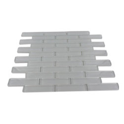 """GlassTileStore - Loft Super White Big Brick Glass Tiles - Loft Super White Big Brick 7/8 x 3 3/4 Glass Tile             This polished bright white glass tile is in a brick pattern. These glass tiles will add durable lasting beauty, and value to your bathroom, kitchen, fireplace or pool installation.          Chip Size: 7/8"""" x 3  3/4""""   Color: White - our bright white   Material: Glass   Finish: Polished   Sold by the Sheet - each sheet measures 13 3/4"""" x 11 5/8""""  (1.11 sq. ft.)   Thickness: 8mm   Please note each lot will vary from the next.            - Glass Tile -"""
