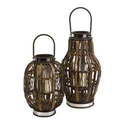 IMAX - Saeran Hurricane Candle Lanterns - Set of 2 - 87305-2 - Shop for Candle Holders from Hayneedle.com! Even if your home is more of a ranch house than a beach house the Saeran Hurricane Candle Lanterns - Set of 2 bring a sea-inspired aesthetic to your space. They're made of rattan banana wood fir wood mirror paper and iron in a deep brown finish. Inside a glass hurricane holds one pillar candle (not included).About IMAXWhat began as a small company importing copper flower containers in 1984 by Al and Faye Bulak has developed into one of the top U.S. import companies serving the At Home market today. IMAX now provides home and garden accessories imported from twelve countries around the world housed in a 500 000 square foot distribution center. Additional sourcing product development and showroom facilities in the USA India and China make IMAX a true global source. They're dedicated to providing products designed to meet your needs. This is achieved through a design and product development team that pushes creativity taste and fashion trends - layering styles periods textures and regions of the world - to create a visually delightful and meaningful environment. At IMAX they believe style integrity and great design can make living easier.