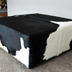 Square ottoman in black and white cowhide