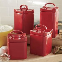 Home Essentials - Cherry Red Ceramic Square Canister Set - Add a pop of color to your kitchen and keep essential ingredients within reach with our durable, and attractive canister set. Artfully designed of glossy red ceramic, these wonderful canisters are ideal for storage of kitchen staples and will spice up any kitchen or living room with culinary style. Both functional and beautiful, they are a joy for daily use and a treasure to pass on through generations!  * Set of 4  * Gift boxed    * Made of ceramic material      Dimensions are as follows:    Small: H: 4.7� D: 4.45�  Medium: H: 5.7� D: 4.45�  Large: H: 7.6� D: 4.45�  Extra Large: H: 7.6� D: 4.45�