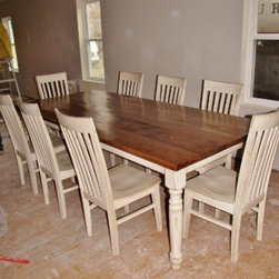 """Past Projects - 96""""x42"""" table with standard overhang, turned legs, 5-6 level of distressing with a two tone finish; Antique White Base with Scuffing with a Provincial Top, paired with 8 of our Tall Mission Chairs stained to match"""