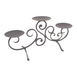 Threshold Three-Pillar Scroll Candleholder - This candleholder is perfect if you're looking for a table centerpiece. It sits up high enough to not bother the platters and serving dishes, yet isn't so high you have to worry about it toppling over. I picture it with big white pillar candles.