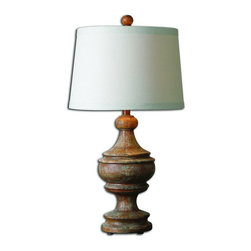 Uttermost - Uttermost 27742  Via Lata Solid Wood Table Lamp - Solid wood base finished in a heavily distressed hand painted burnt orange with black accents. the round, slightly tapered hardback shade is an ivory linen fabric with natural slubbing.