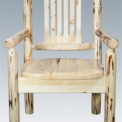 """Montana Woodworks - Wooden Captain's Chair - Hand crafted. Skip peeled by hand using old fashioned draw knives. Ergonomically designed standard wooden seat. Heirloom quality. Solid lodge pole pine legs and spindles. Contoured and comfortable seat. Slat style back increases comfort. Made from U.S. solid grown wood. Lacquered finish. Made in U.S.A.. No assembly required. Seat height: 18 in.. Overall: 19 in. W x 18 in. D x 38 in. H (25 lbs.). Warranty. Use and Care InstructionsThe Captain's Chair by Montana Woodworks is the perfect addition to your dining set. Placed at the head of the table or used all around, these chairs are sure to please the """"Captain"""" of your table! Each piece signed by the artisan who makes it."""