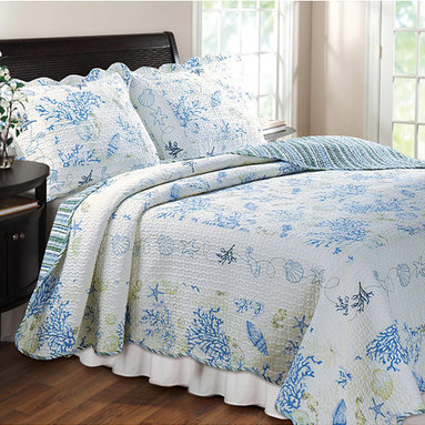 None - Coral Blue 3-Piece Quilt Set - Update your bedroom with a modern nautical theme,starting with this coastal quilt set that features lovely embroidered sea animals in soft hues of blues and corals. Change things up with the reversible side,featuring a modern stripe in matching hues.