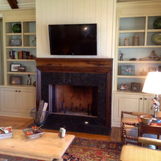 Eclectic Indoor Fireplaces by Total Quality Home Builders, Inc.