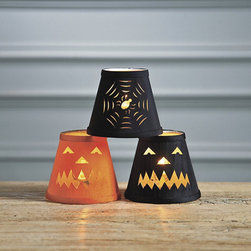 Spider Web Chandelier Shade - Add a little bit of fun to your chandelier with these pumpkin and spiderweb lamp shades. I can imagine that kids would get a kick out of putting these up every year too.